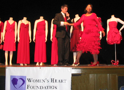 a Woman models her red dress